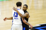 Creighton's Christian Bishop (13) hugs UC Santa Barbara's Brandon Cyrus after a college basketball game in the first round of the NCAA tournament at Lucas Oil Stadium in Indianapolis Saturday, March 20, 2021. Creighton won 63-62. (AP Photo/Mark Humphrey)