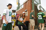 Green Bay Packers' fans make their way to NFL football training camp Saturday, July 31, 2021, in Green Bay, Wis. (AP Photo/Matt Ludtke)