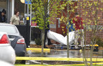 FILE-In this Sunday, April 22, 2018 file photo, a body is carried out of a Waffle House in Nashville, Tenn. At least four people died after a gunman opened fire at the restaurant early Sunday. This was one of this year's top stories in Tennessee. (George Walker IV/The Tennessean via AP, File)