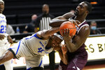 New Orleans forward Jahmel Myers (4) fights for a rebound with Texas A&M forward Kevin Marfo (45) during the first half of an NCAA college basketball game Sunday, Nov. 29, 2020, in College Station, Texas. (AP Photo/Sam Craft)