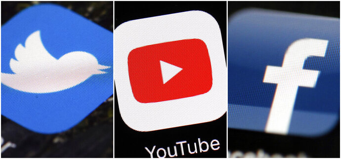 FILE - This combination of images shows logos for companies from left, Twitter, YouTube and Facebook. The British government announced Wednesday Feb. 12, 2020, it will give regulators the power to fine social media companies for harmful material on their platforms. (AP Photos/File)