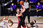 Miami Heat's Goran Dragic (7) shoots during the second half in Game 6 of basketball's NBA Finals against the Los Angeles Lakers Sunday, Oct. 11, 2020, in Lake Buena Vista, Fla. (AP Photo/Mark J. Terrill)