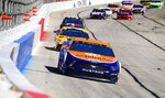 Brad Keselowski leads a row of cars as they come through the front stretch during a Monster Energy NASCAR Cup Series auto race at Atlanta Motor Speedway, Sunday, Feb. 24, 2019, in Hampton, Ga. Keselowski won the race. (AP Photo/Scott Cunningham)
