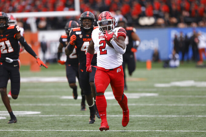 Utah running back Zack Moss (2) runs for a 91-yard touchdown during the first half of the team's NCAA college football game against Oregon State in Corvallis, Ore., Saturday, Oct. 12, 2019. (AP Photo/Amanda Loman)