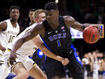 Duke's Zion Williamson (1) is defended by Notre Dame's Dane Goodwin (23) during the first half of an NCAA college basketball game Monday, Jan. 28, 2019, in South Bend, Ind. (AP Photo/Robert Franklin)