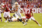Tennessee quarterback Jarrett Guarantano (2) runs for a gain against Arkansas during the first half of an NCAA college football game Saturday, Nov. 7, 2020, in Fayetteville, Ark. (AP Photo/Michael Woods)