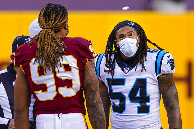 Carolina Panthers outside linebacker Shaq Thompson (54) and Washington Football Team defensive end Chase Young (99) watching the coin flip before the start of an NFL football game, Sunday, Dec. 27, 2020, in Landover, Md. (AP Photo/Susan Walsh)