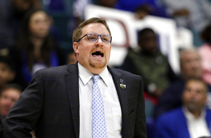 New Orleans coach Mark Slessinger shouts during the first half of the team's NCAA college basketball game against Abilene Christian for the Southland Conference men's tournament title Saturday, March 16, 2019, in Katy, Texas. (AP Photo/Michael Wyke)