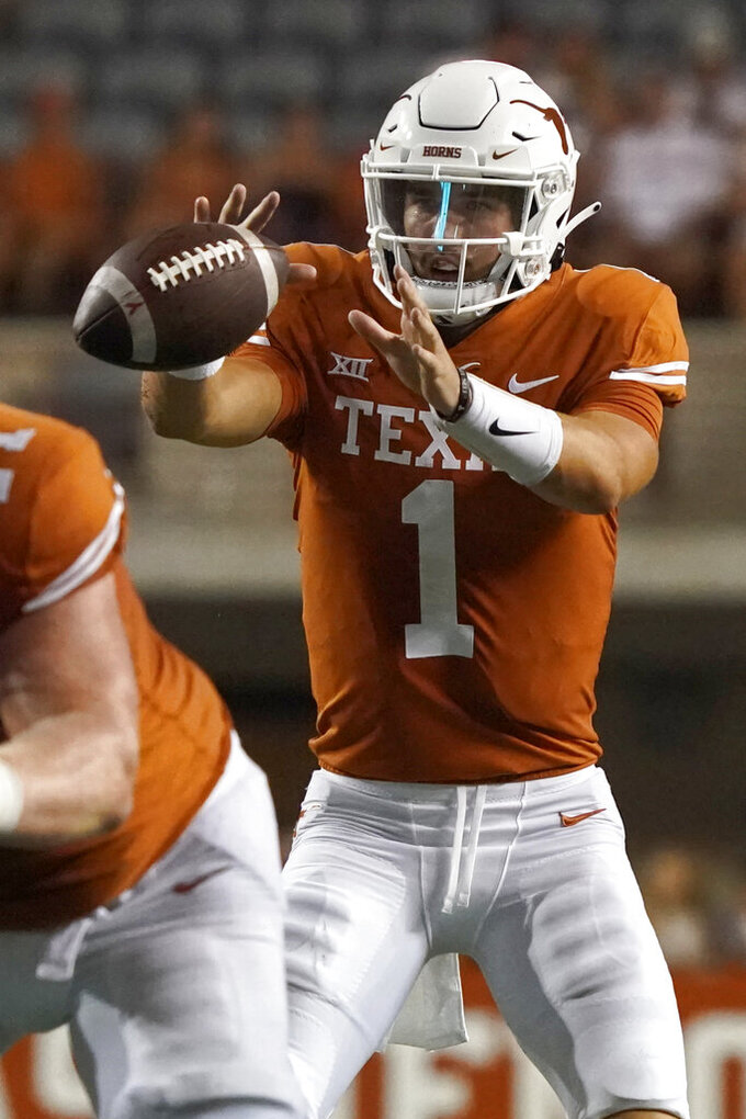 Texas quarterback Hudson Card (1) takes a snap during the second half of an NCAA college football game against Rice, Saturday, Sept. 18, 2021, in Austin, Texas. (AP Photo/Chuck Burton)