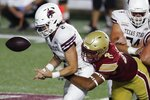 Boston College defensive lineman Brandon Barlow sacks Texas State quarterback Brady McBride (2) during the first half of an NCAA college football game Saturday, Sept. 26, 2020, in Boston. (AP Photo/Michael Dwyer)