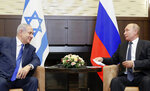 Russian President Vladimir Putin, right, and Israeli Prime Minister Benjamin Netanyahu talk during their meeting in Sochi, Russia, Thursday, Sept. 12, 2019. Ahead of Israel's early parliamentary election next week, Russian President Vladimir Putin says the Kremlin has an interest in who wins power. (Shamil Zhumatov/Pool Photo via AP)