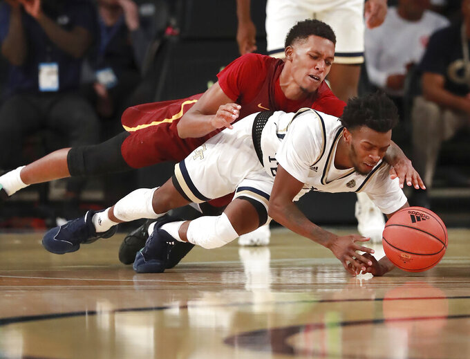 Georgia Tech guard Bubba Parham, bottom, and Bethune-Cookman guard Isaiah Bailey, top, dive for the ball during the first half of an NCAA college basketball game Sunday, Dec. 1, 2019, in Atlanta. (Curtis Compton/Atlanta Journal-Constitution via AP)