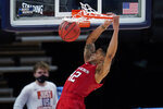 Rutgers guard Jacob Young (42) dunks against Clemson during the first half of a men's college basketball game in the first round of the NCAA tournament at Bankers Life Fieldhouse in Indianapolis, Friday, March 19, 2021. (AP Photo/Paul Sancya)