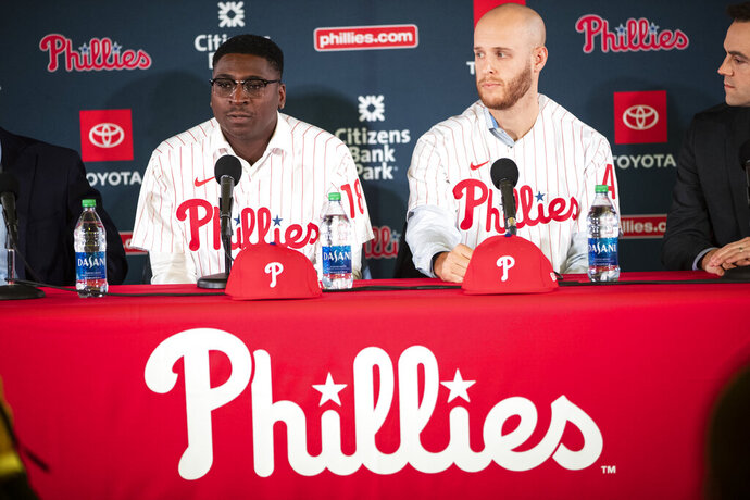 FILE - In this Dec. 16, 2019, file photo, Philadelphia Phillies' Didi Gregorius, left, and Zack Wheeler take part in a news conference in Philadelphia. The Phillies enter spring training with a new manager who has a winning pedigree. Joe Girardi, who led the Yankees to a World Series title, takes over in Philadelphia while righty Wheeler and shortstop Gregorious were the biggest on-field additions. (AP Photo/Matt Rourke, File)