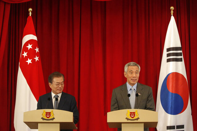 South Korea President Moon Jae-in, left, and Singapore Prime Minister Lee Hsien Loong hold a press conference at the Istana Presidential Palace in Singapore, Thursday, July 12, 2018. Moon is on a three-day visit to Singapore. (Wallace Woon/Pool Photo via AP)