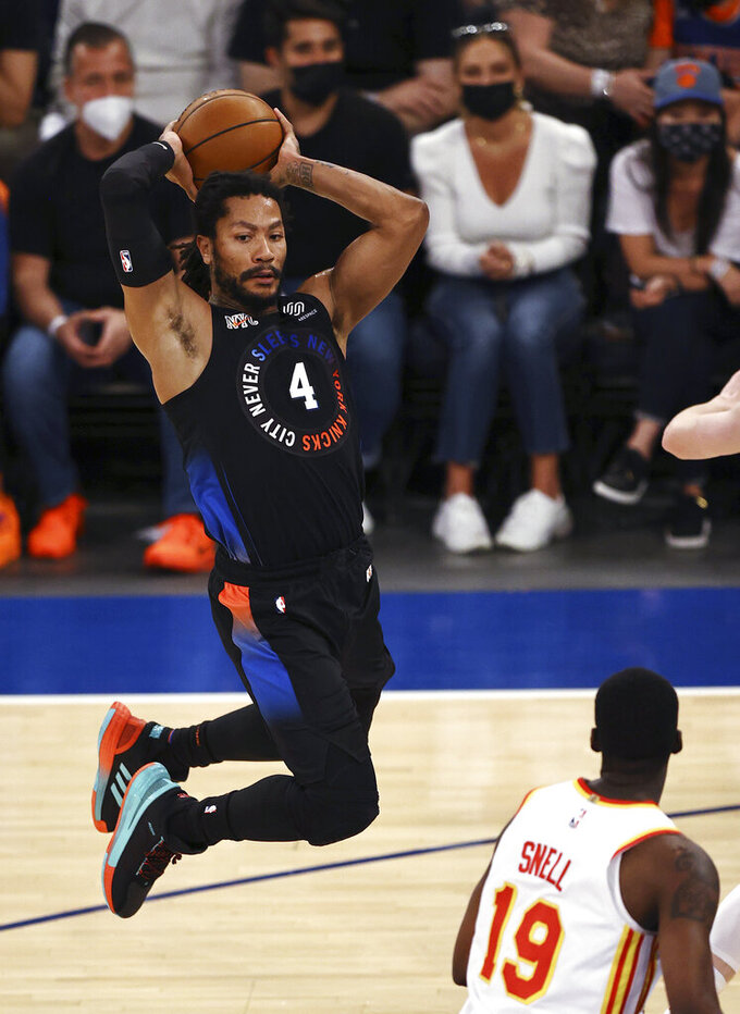 New York Knicks' Derrick Rose (4) passes the ball past Atlanta Hawks' Tony Snell (19) duirng the second quarter of Game 2 in an NBA basketball first-round playoff series Wednesday, May 26, 2021, in New York. (Elsa/Pool Photo via AP)