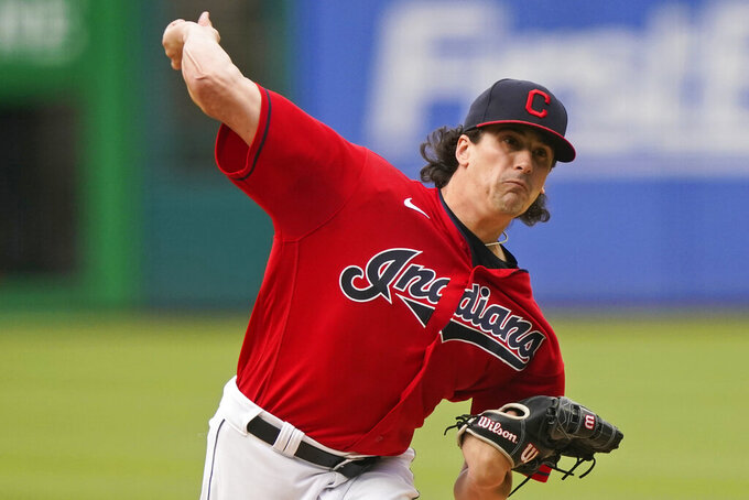 Cleveland Indians starting pitcher Cal Quantrill delivers in the first inning of the team's baseball game against the Tampa Bay Rays, Thursday, July 22, 2021, in Cleveland. (AP Photo/Tony Dejak)
