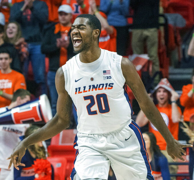 Illinois guard Da'Monte Williams (20) reacts to scoring a 3-pointer against Nebraska during the first half of an NCAA college basketball game in Champaign, Ill., Saturday. Feb. 2, 2019. (AP Photo/Robin Scholz)