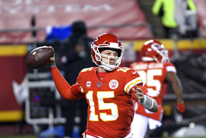 Kansas City Chiefs quarterback Patrick Mahomes throws a pass during the first half of the AFC championship NFL football game against the Buffalo Bills, Sunday, Jan. 24, 2021, in Kansas City, Mo. (AP Photo/Reed Hoffmann)