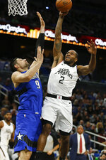 Los Angeles Clippers forward Kawhi Leonard (2) drives to the hoop for a dunk over Orlando Magic center Nikola Vucevic (9) during the second quarter of an NBA basketball game in Orlando, Fla., Sunday, Jan. 26, 2020. (AP Photo/Reinhold Matay)