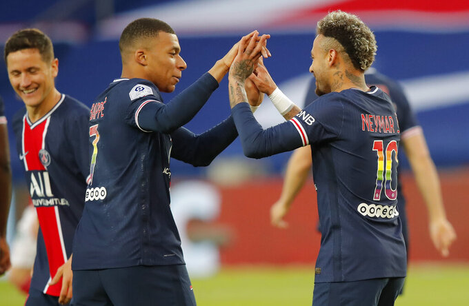 PSG's Neymar, right, celebrates with PSG's Kylian Mbappe after he scores his sides first goal during the French League One soccer match between Paris Saint-Germain and Reims at the Parc des Princes stadium in Paris, France, Sunday, May 16, 2021. (AP Photo/Michel Euler)