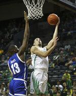 Texas-Arlington's Jabari Narcis, pressures Oregon's Chris Duarte on a shot during the first half of an NCAA college basketball game in Eugene, Ore., Sunday, Nov. 17, 2019. (AP Photo/Chris Pietsch)