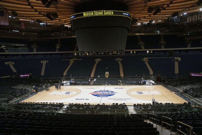 Madison Square Garden is shown after NCAA college basketball games in the men's Big East Conference tournament were cancelled due to concerns about the coronavirus, Thursday, March 12, 2020, in New York. The major conferences in college sports have all cancelled their basketball tournaments because of the new coronavirus, putting the celebrated NCAA Tournament in doubt. (AP Photo/Mary Altaffer)