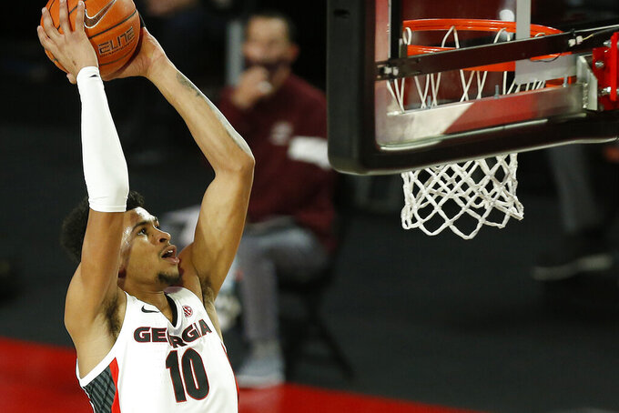Georgia's Toumani Camara (10) goes to dunk the ball during an NCAA college basketball game against Montana Tuesday, Dec. 8, 2020, in Athens, Ga. (Joshua L. Jones/Athens Banner-Herald via AP)