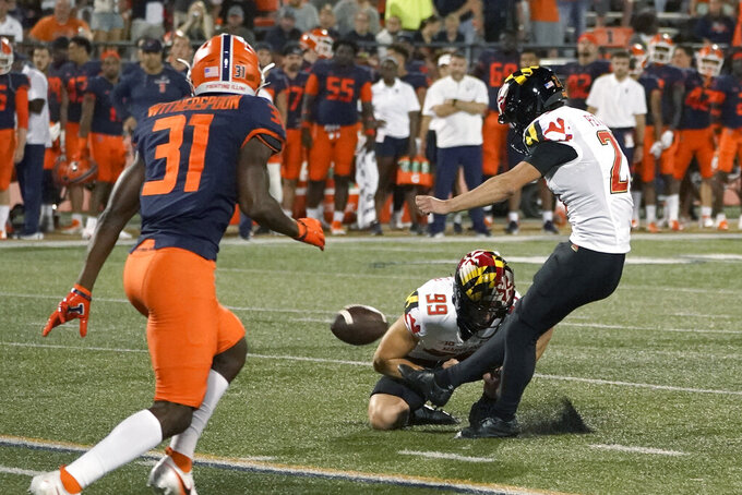 Maryland's Joseph Petrino kicks a field goal from the hold of Colton Spangler during the first half of the team's NCAA college football game against Illinois on Friday, Sept. 17, 2021, in Champaign, Ill. (AP Photo/Charles Rex Arbogast)