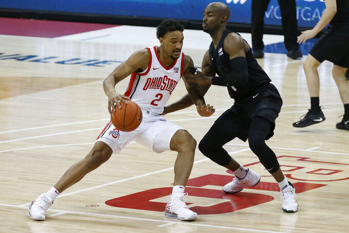 Ohio State's Musa Jallow, left, drives to the basket against Michigan State's Joshua Langford during the first half of an NCAA college basketball game Sunday, Jan. 31, 2021, in Columbus, Ohio. (AP Photo/Jay LaPrete)