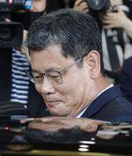 South Korean Unification Minister Kim Yeon-chul gets into a car as he leaves the government complex in Seoul, South Korea, Friday, June 19, 2020. South Korean President Moon Jae-in on Friday accepted the resignation of his point man on North Korea, who had asked to quit after the North destroyed a liaison office while ramping up pressure against Seoul amid stalled nuclear negotiations with the Trump administration. (AP Photo/Lee Jin-man)