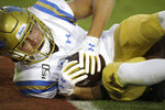 UCLA's Kyle Philips scores a touchdown against Stanford during the first half of an NCAA college football game Thursday, Oct. 17, 2019, in Stanford, Calif. (AP Photo/Ben Margot)