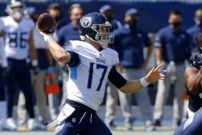 Tennessee Titans quarterback Ryan Tannehill (17) passes against the Jacksonville Jaguars in the first half of an NFL football game Sunday, Sept. 20, 2020, in Nashville, Tenn. (AP Photo/Mark Zaleski)