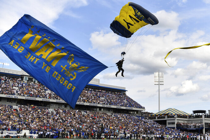 Leap Frogs airmen parachute into the stadium before an NCAA college football game, between Navy and Air Force, Saturday, Sept. 11, 2021, in Annapolis, Md. (AP Photo/Terrance Williams)
