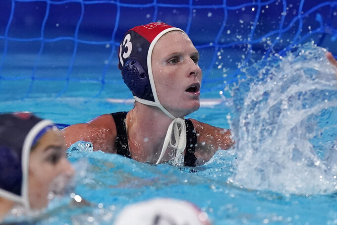 United States' goalkeeper Amanda Longan (13) plays against Canada in the fourth quarter of a quarterfinal round women's water polo match at the 2020 Summer Olympics, Tuesday, Aug. 3, 2021, in Tokyo, Japan. It is her first game at the Olympics. (AP Photo/Mark Humphrey)