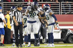 Seattle Seahawks defensive end Jadeveon Clowney (90) is congratulated by strong safety Bradley McDougald (30) after scoring against the San Francisco 49ers during the first half of an NFL football game in Santa Clara, Calif., Monday, Nov. 11, 2019. (AP Photo/Tony Avelar)