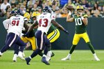 Green Bay Packers' Jordan Love throws during the first half of a preseason NFL football game against the Houston Texans Saturday, Aug. 14, 2021, in Green Bay, Wis. (AP Photo/Matt Ludtke)