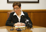 FILE - In this Feb. 12, 2015, file photo, Oregon House SpeakerTina Kotek, D-Portland, listens to a question during a news conference in her office at the Capitol in Salem, Ore. Police declared a riot, made multiple arrests and used tear gas to disperse protesters in a residential neighborhood in Portland, Ore., as unruly demonstrations continue in the city. The Portland Police Bureau said Wednesday, July 1, 2020, they arrested 28 protesters on charges including disorderly conduct, interfering with a police officer, riot and assault on a police officer during protests late Tuesday that stretched into the early morning hours. Kotek condemned the police response and the use of tear gas on Wednesday in a strongly worded letter to Mayor Ted Wheeler that called the officers' actions