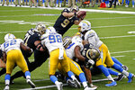 New Orleans Saints quarterback Drew Brees (9) dives over the goal line for a touchdown in the first half of an NFL football game against the Los Angeles Chargers in New Orleans, Monday, Oct. 12, 2020. (AP Photo/Butch Dill)