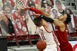 Nebraska's Trey McGowens tries to shoot over Wisconsin's Micah Potter during the second half of an NCAA college basketball game Tuesday, Dec. 22, 2020, in Madison, Wis. (AP Photo/Morry Gash)