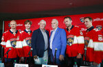 FILE - In this July 2, 2019, file photo, Florida Panthers President of Hockey Operations & General Manager Dale Tallon, third from left, and head coach Joel Quenneville, third from right, pose with new players Anton Stralman, left, Sergei Bobrovsky, second from left, Brett Connolly, second from right, and Noel Acciari, right, after a news conference in Sunrise, Fla. With Tampa Bay, Boston, the Toronto Maple Leafs and refueled Florida Panthers, the Atlantic Division looks like murderer's row. (AP Photo/Wilfredo Lee, File)
