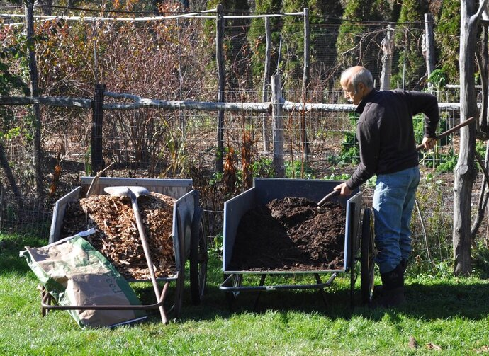 This undated photo shows mulches ready for spreading in New Paltz, N.Y. Compost and wood chips are among the many organic mulches that provide multiple benefits to plants and the soil when spread on top of the ground. (Lee Reich via AP)