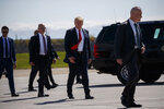 President Donald Trump walks to Air Force One after meeting troops at Joint Base Elmendorf-Richardson for a refueling stop en route to Japan for a four-day state visit, Friday, May 24, 2019, in Anchorage. (AP Photo/Evan Vucci)