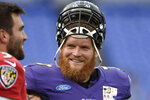 FILE - In this Aug. 1, 2016, file photo, Baltimore Ravens guard Marshal Yanda, right, talks with quarterback Joe Flacco during practice at the NFL football teams training camp in Baltimore. Yanda was selected to the 2010s NFL All-Decade Team announced Monday, April 6, 2020, by the NFL and the Pro Football Hall of Fame. (AP Photo/Gail Burton, File)