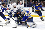 Tampa Bay Lightning's Pat Maroon (14) is unable to score past St. Louis Blues goaltender Jordan Binnington and Mackenzie MacEachern (28) during the first period of an NHL hockey game Tuesday, Nov. 19, 2019, in St. Louis. (AP Photo/Jeff Roberson)
