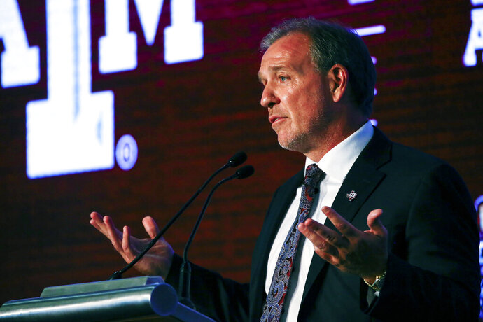 Texas A&M head coach Jimbo Fisher speaks during the NCAA college football Southeastern Conference Media Days, Tuesday, July 16, 2019, in Hoover, Ala. (AP Photo/Butch Dill)