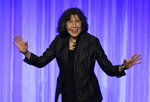 Honoree Lily Tomlin arrives onstage to collect her award at