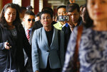 Maria Ressa, center, the award-winning head of a Philippine online news site Rappler, is escorted into the court room to post bail at a Regional Trial Court following an overnight arrest by National Bureau of Investigation agents on a libel case Thursday, Feb. 14, 2019 in Manila, Philippines. Ressa was freed on bail Thursday after her arrest in a libel case. (AP Photo/Bullit Marquez)