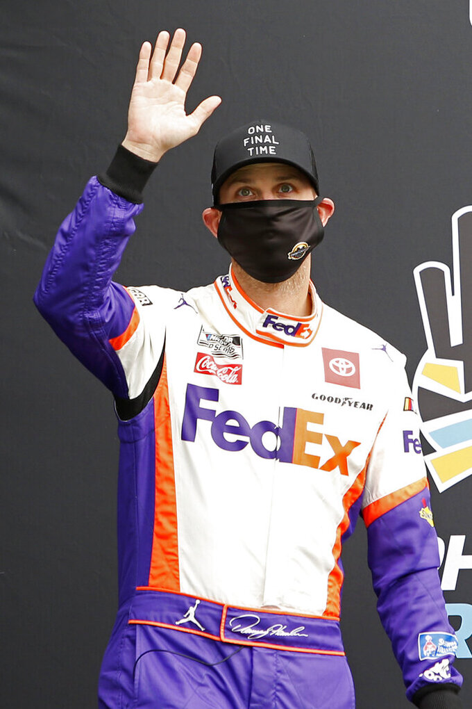 Denny Hamlin waves to the crowd during driver introductions prior to the NASCAR Cup Series auto race at Phoenix Raceway, Sunday, Nov. 8, 2020, in Avondale, Ariz. (AP Photo/Ralph Freso)