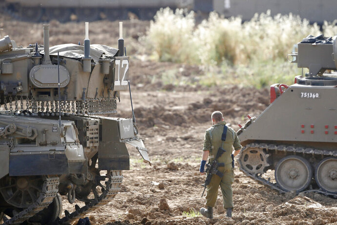 An Israeli soldier stands at a gathering point in Israel Gaza Border, Monday, May 6, 2019. The Israeli army on Monday lifted protective restrictions on residents in southern Israel, while the Hamas militant group's radio station in the Gaza Strip reported a cease-fire, signaling a deal had been reached to end the bloodiest fighting between the two sides since a 2014 war. (AP Photo/Ariel Schalit)